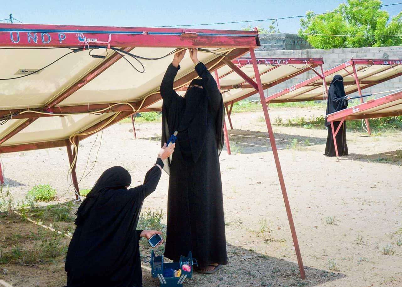 Women fix solar panels