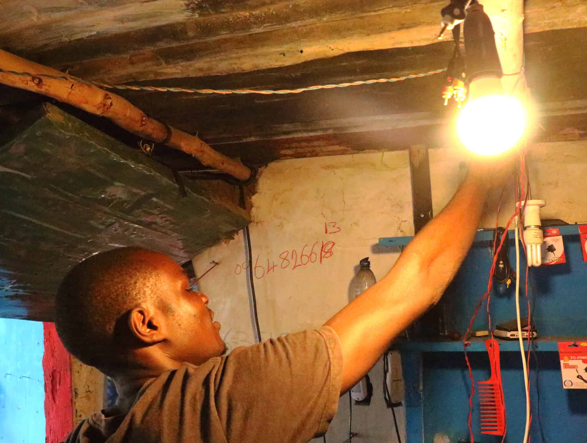 A man adjusts a lightbulb