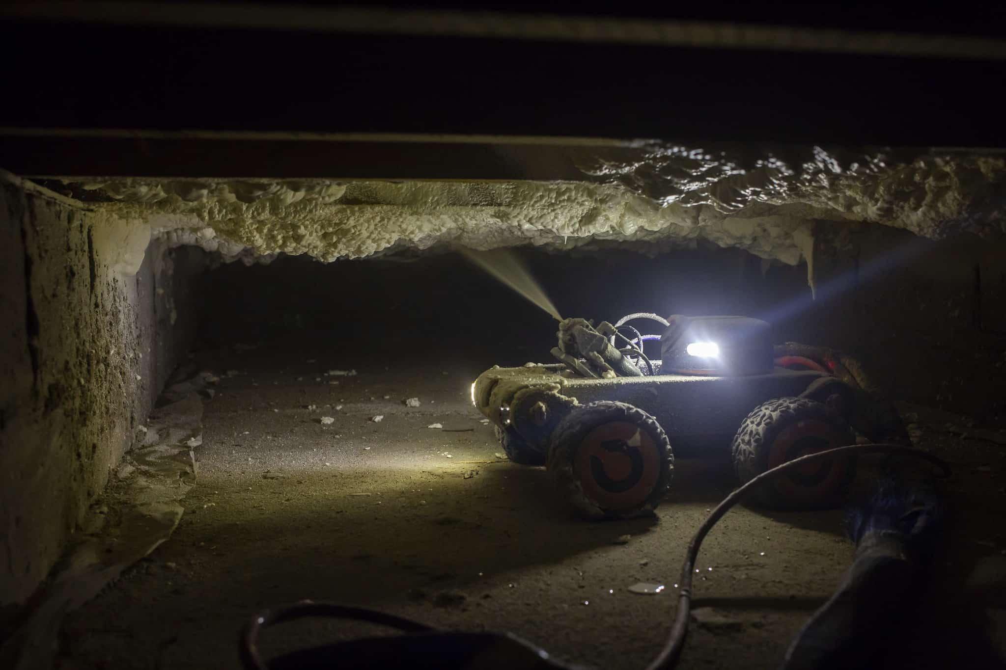A wheeled robot spraying foam