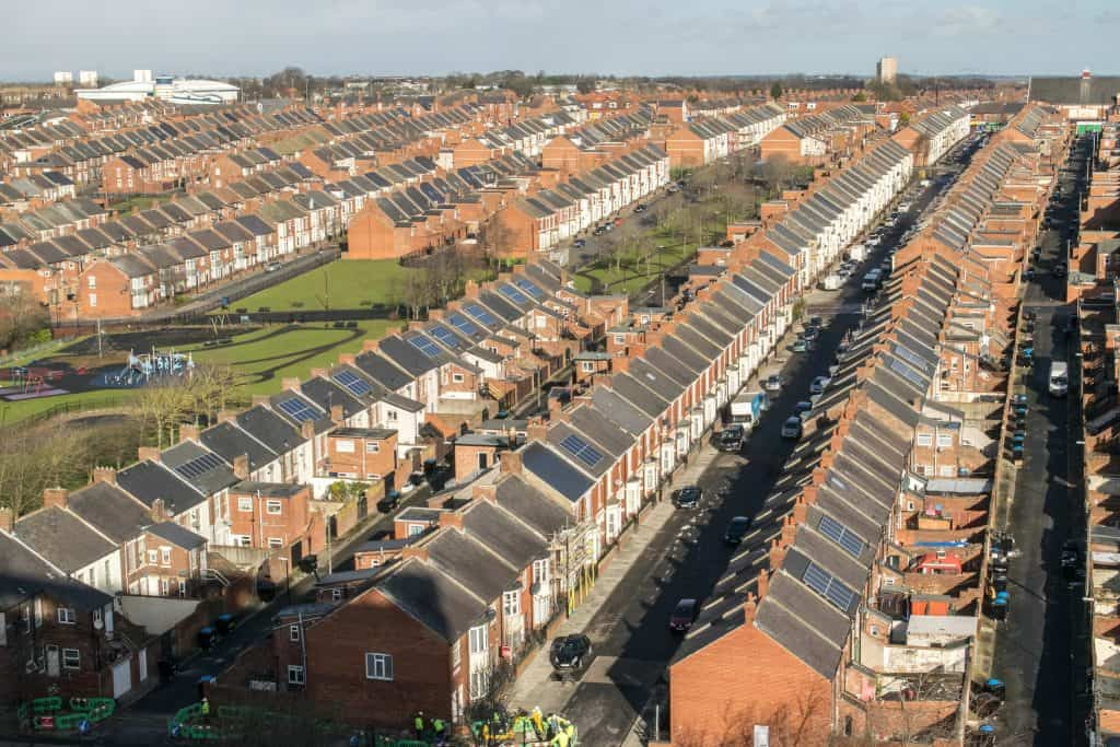 An aerial image of streets with solar panels on houses