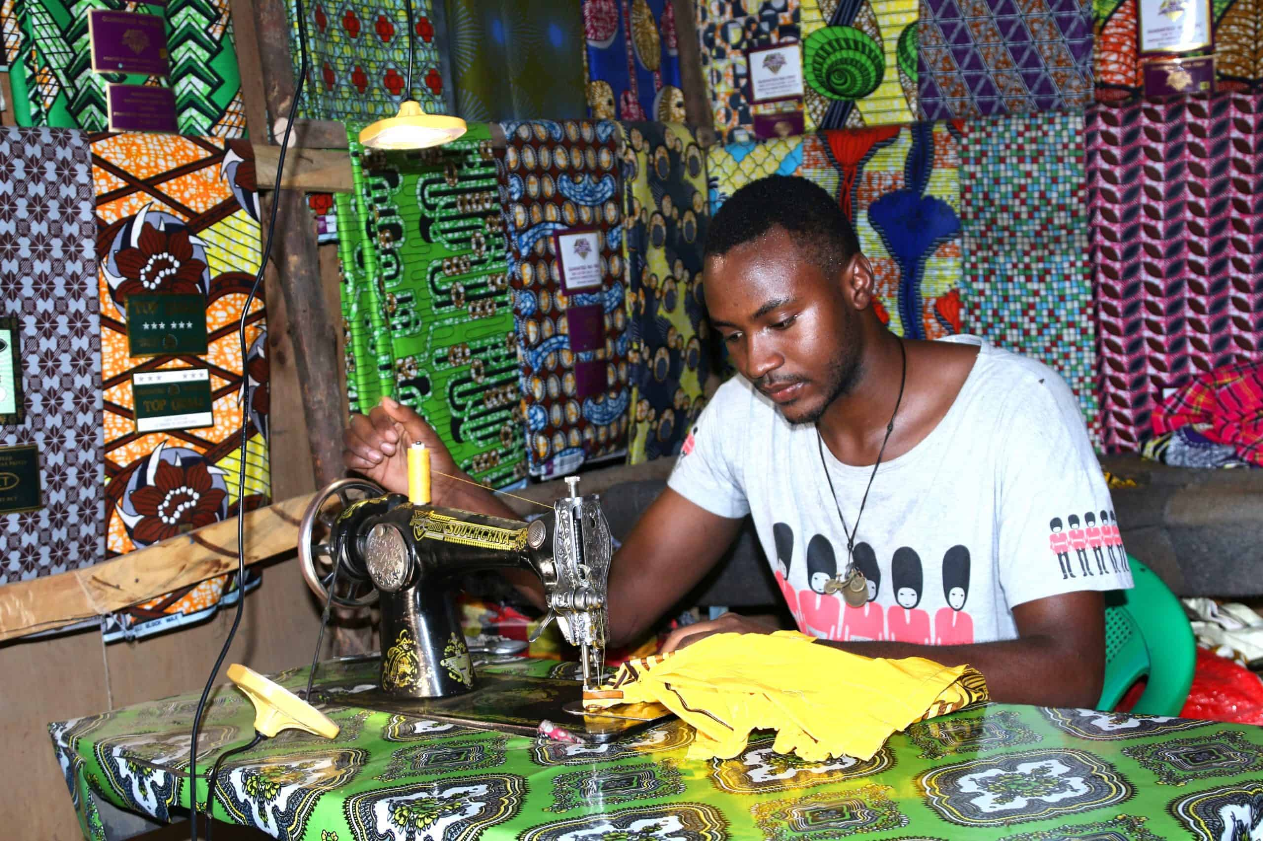 A man using a sewing machine