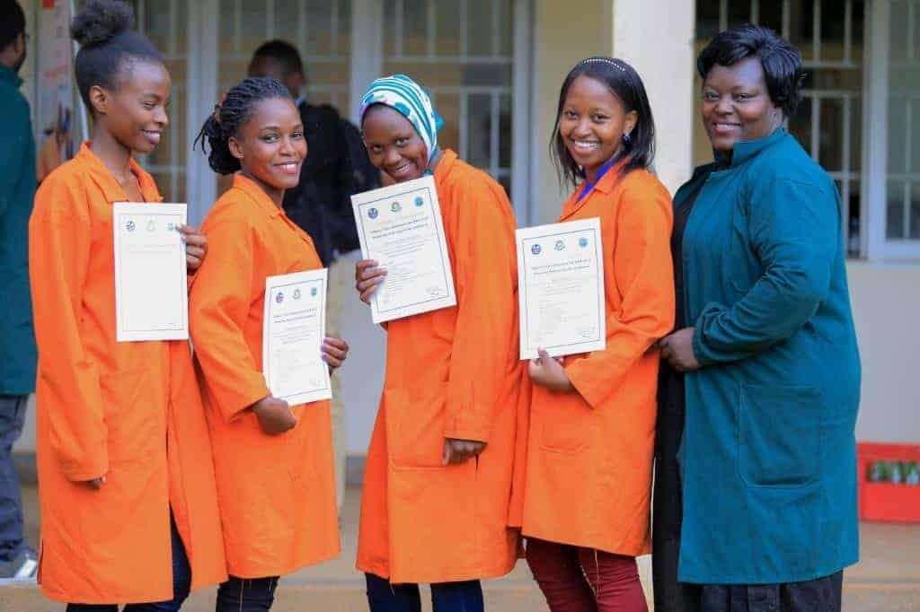 Women holding certificates