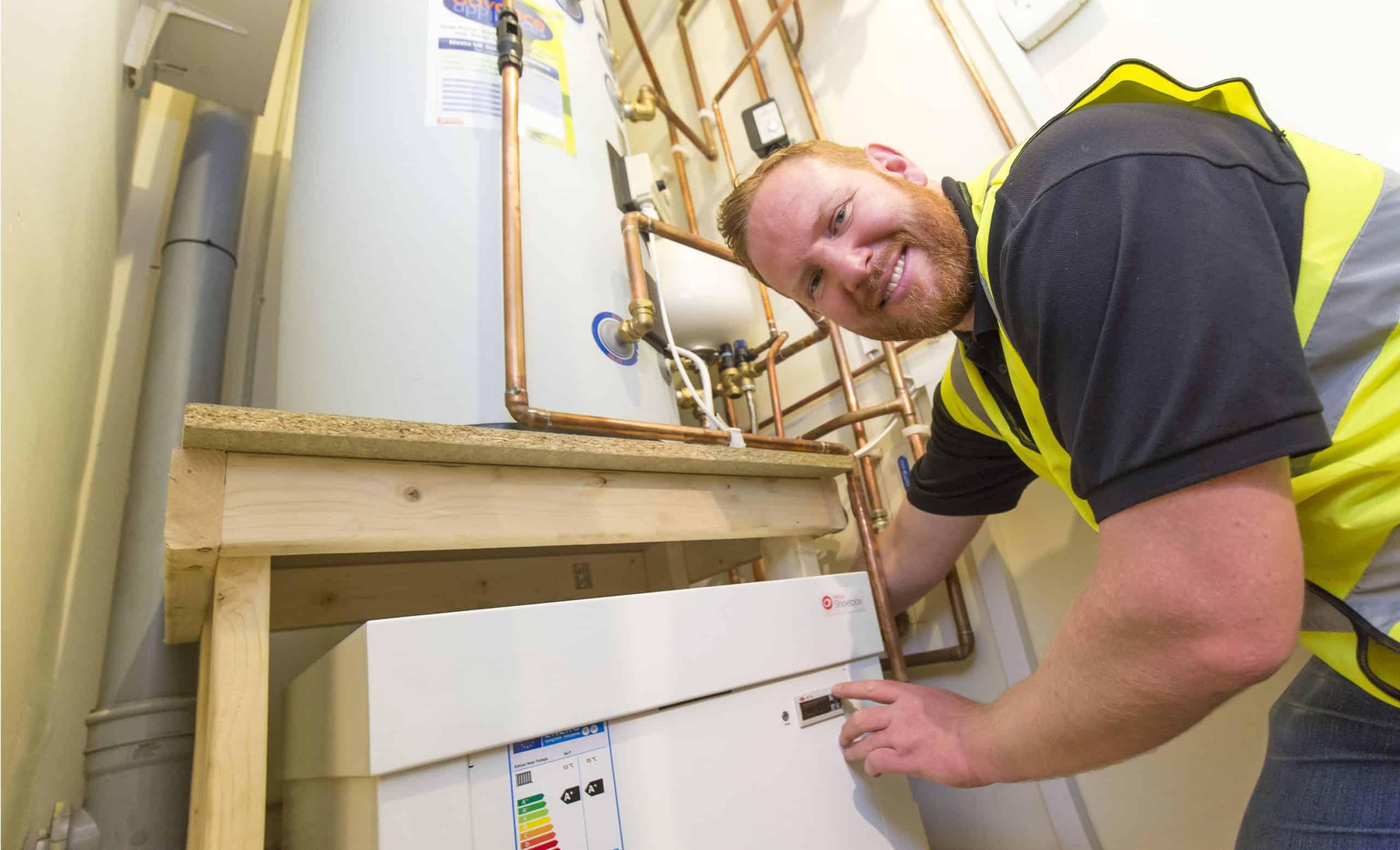 A man next to a boiler