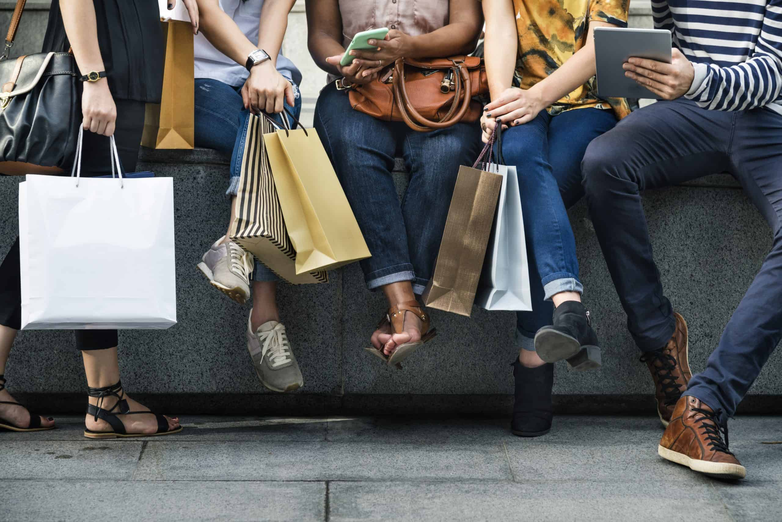 A group of people holding shopping bags
