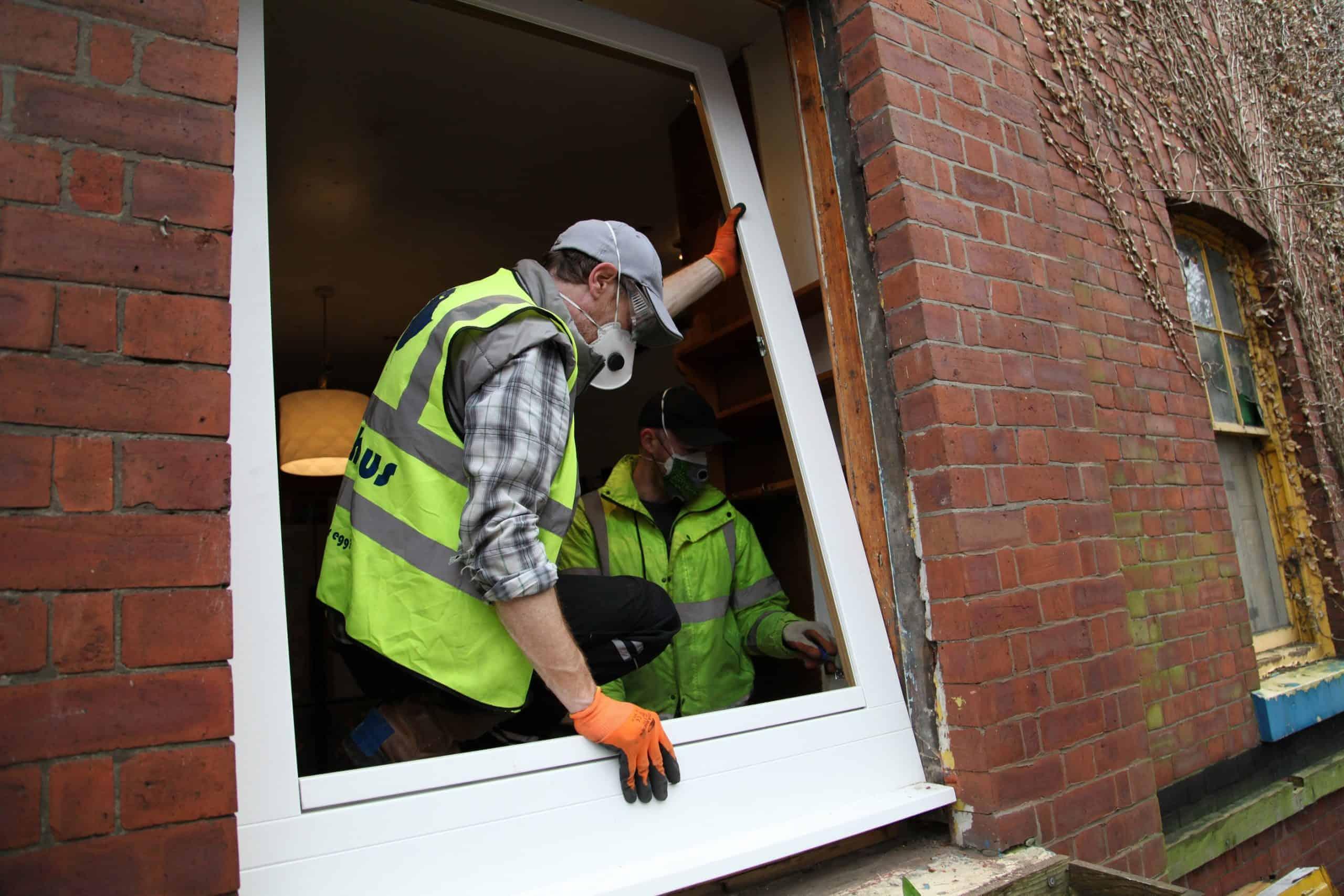 Two men fitting windows