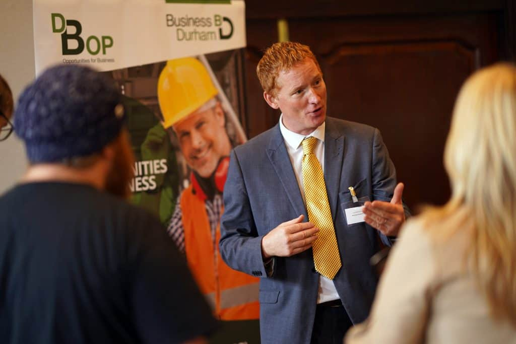 A man speaks at an event