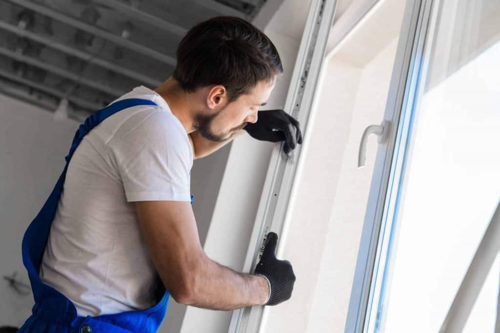 A man fitting a window
