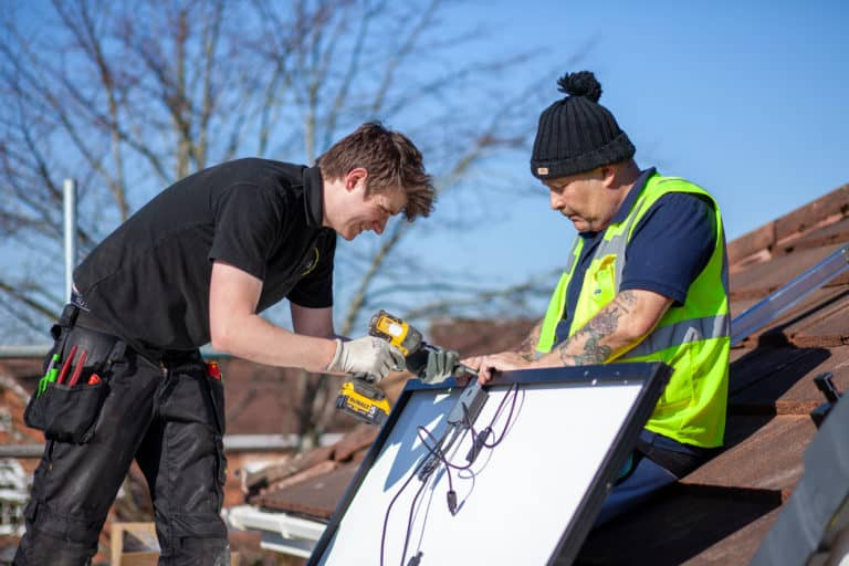 Two construction workers on a roof